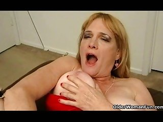 Busty granny in stockings fucks dildo
