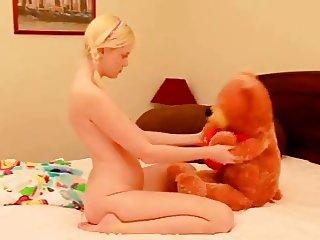 Sensual Blonde Tease with Teddy Bear & Dildo