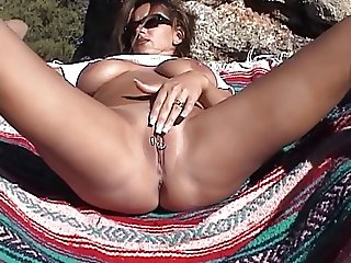 Hottie using her dildo outdoors