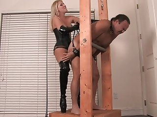 Blonde mistress strapon fucks him