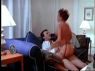 British MILF Nici Stirling gets fucked on a sofa