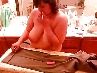 wife smoking while ironing