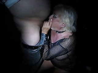 Old blonde hooker services men in sex cinema