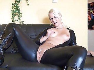 Blond girl masturbates in Latexsuit