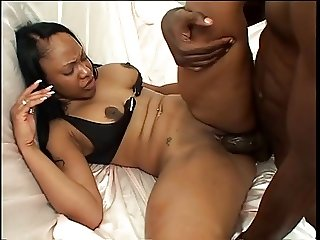 Black beauty gets her snatch boned with black dick