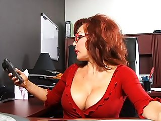 Cute cock sucking redhead takes cumshot from black guy in office