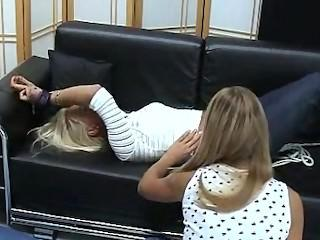 Eva tickled on the couch
