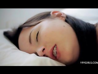 Sleeping girl has erotic dreams while anal fingering