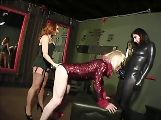 Two bitches with dildo fuck the blonde