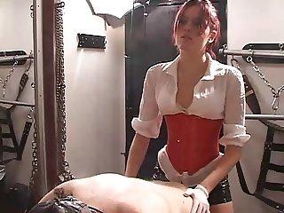 Redhead Mistress in Dungeon