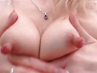 Mature playing with her long nipples