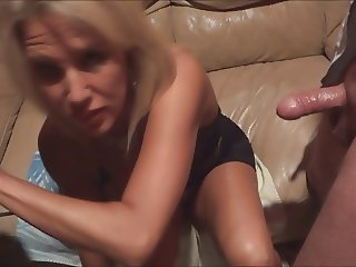 Wife gets covered in cum at the Gloryhole