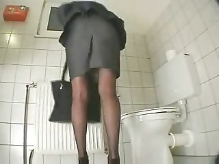secretary masturbates with dildo at the restroom