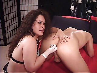 Cute brunette gives lucky guy a rimjob before fucking his ass with dildo