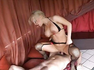 Curvy blonde in fishnets takes two cocks in her mouth and smooth bald pussy