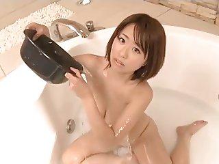 mizuki play a lotion in a bathroom