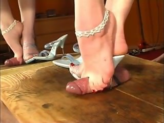 Sexy feet and heels play with a dick