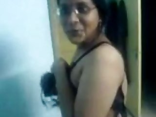 Chubby Tamil girl in glasses puts on a good striptease show