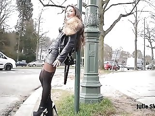 hooker public flashing smoking & leather miniskirt pantyhose