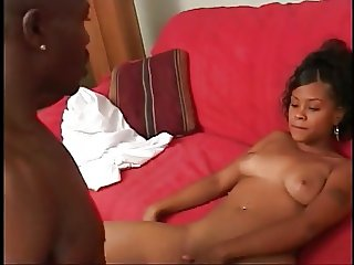 Ethnic babe rides chocolate cock