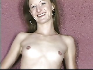 Super skinny brunette in sexy black pumps spreads her pussy wide