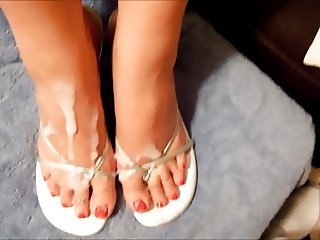 Cumshot on feet in silver strap shoes