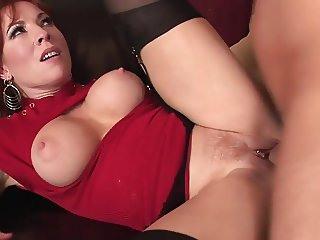 Sexy redhead milf in stockings fucks really good