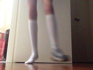Teen girl messing around in knee high socks