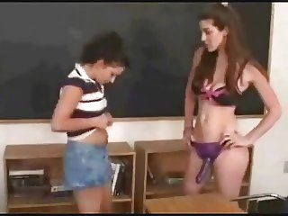 Lez Teacher giving student anal lessons.