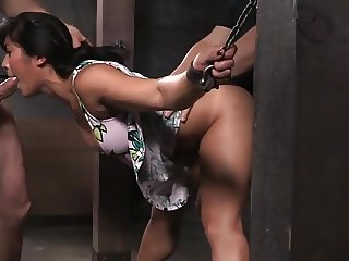 Shackled Asian slut's pussy and mouth used