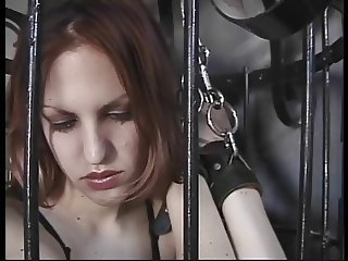 Slave bitch let out of her cage for some flogging