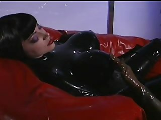 Latex Mistress works her slave
