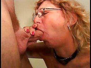 An old milf slut in glasses sucks a mean cock
