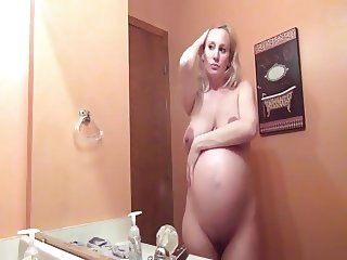 Pregnant babe in the bathroom