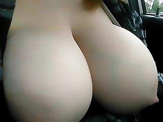 breasts swollen with milk splashing
