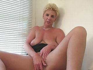 Dutch mature horny housewife masturbating