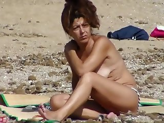 Portuguese mature topless at the beach
