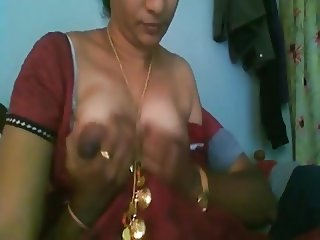 Young boy playing with desi aunty's big boobs