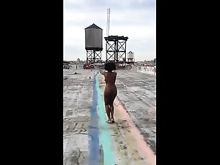 Black woman naked on the rooftop