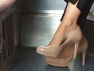 Beautiful feet in shoes high heels in train 3