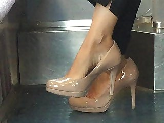 Beautiful feet in shoes high heels in train 2