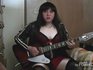 Smoking shemale playing guitar