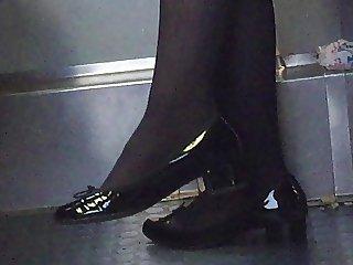 Beautiful feet in shoes high heels in train 10
