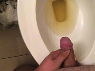 Soft uncut cock pissing