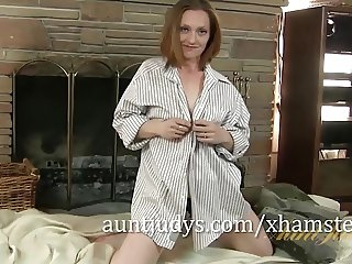 Redheaded MILF Amber Moans While She Touches Herself