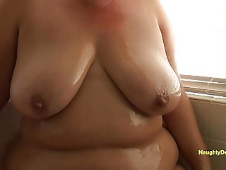 Desiree oiling her plush body