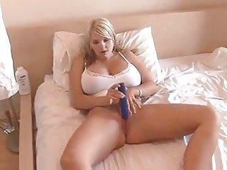 Super hot British chick with massive tits fucks herself