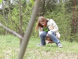 Girl piss outdoors