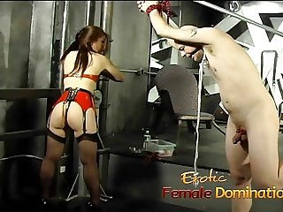 Tied-up and gagged stud has his cock pleasured by an Asian