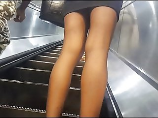 Metro girl in shiny black bantyhose